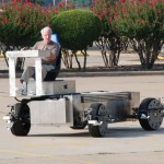 Roam Transport MicroWay chassis in turn on parking lot test. MegaRail